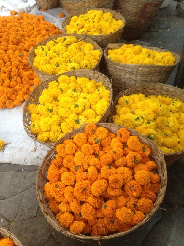 Baskets bursting with freshly picked Marigolds line streets during Diwali