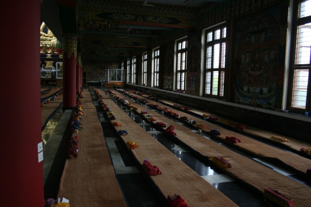 Rows upon rows of prayer mats line the hallway to the alter