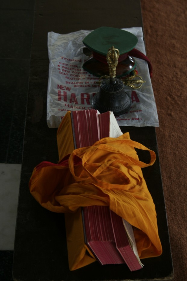 Prayer books and other holy paraphenelia at a monk's station