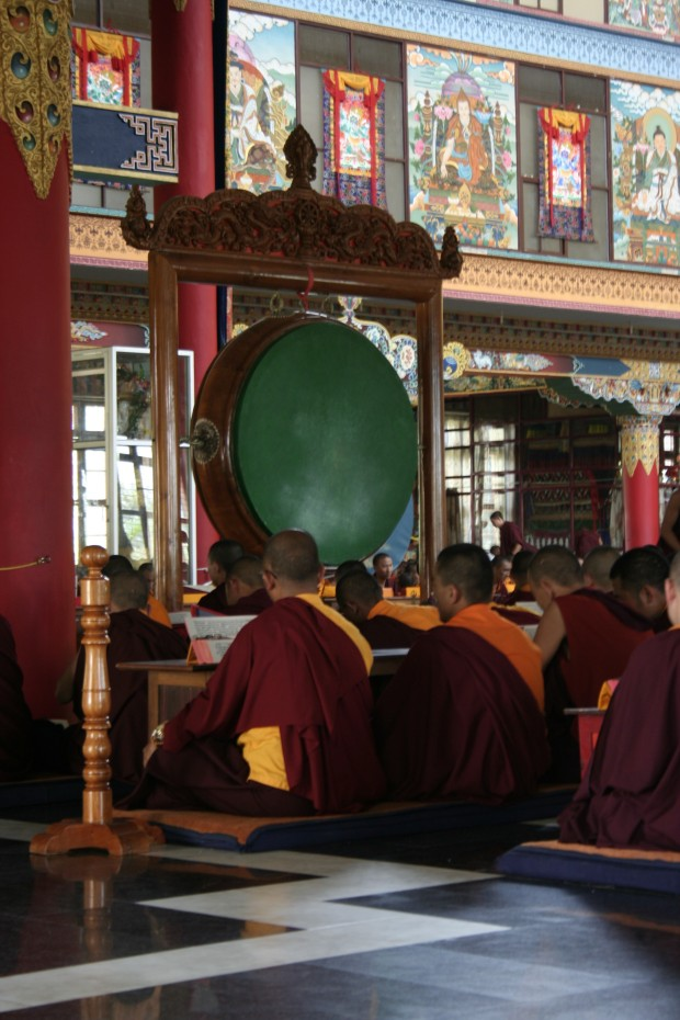 Giant gongs and prayer drums clang and clash in lieu of the chanting