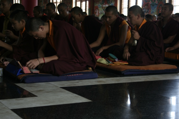The monks rock back and forth to the beat of the gongs and the rhythm of the bowls
