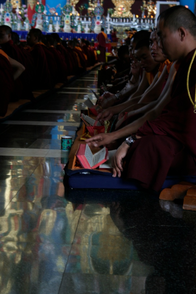 The prayers begin in the glow of The Buddha